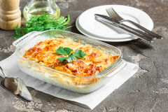 Potatoes baked with cheese, apples and fresh green vegetables. Potato gratin with cream cheese and fresh herbs Stock Photo