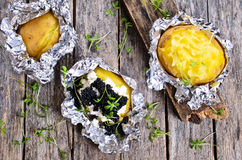 Potatoes baked in foil Royalty Free Stock Image