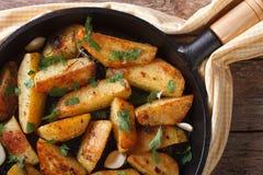 Potatoes baked in a pan closeup horizontal top view Stock Image