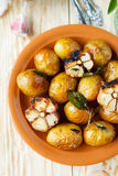 Potatoes baked in their skins with garlic Royalty Free Stock Photography