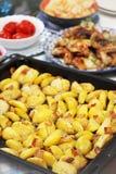 Potatoes on a baking sheet Royalty Free Stock Image