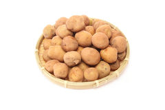 Potatoes on a bamboo colander Stock Images