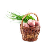 Potatoes in the basket. Potatoes in a basket on a white background Royalty Free Stock Images