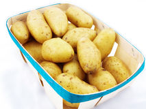 Potatoes in basket Stock Photos