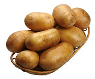 Potatoes in a basket, isolated Stock Images