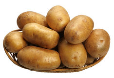 Potatoes in a basket, isolated Stock Photography