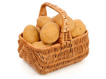 Potatoes in basket. Isolated on white Royalty Free Stock Photo