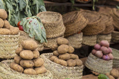 Potatoes in baskets on a vegetables market Royalty Free Stock Photo