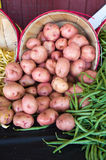 Potatoes and beans on a market vertical Stock Image