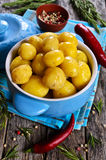 Potatoes boiled. Potatoes cooked in a ceramic dish on a wooden surface royalty free stock photography