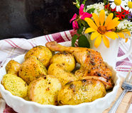 Potatoes boiled in their jackets and crisp chicken. New potatoes boiled in their jackets and crisp chicken Royalty Free Stock Image