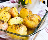 Potatoes boiled in their jackets. New potatoes boiled in their jackets with seasoning Stock Image