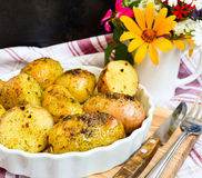 Potatoes boiled in their jackets. With seasoning Stock Image