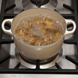 Potatoes boiling in pot Royalty Free Stock Photos