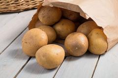 Potatoes in a brown paper bag Stock Image