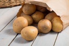 Potatoes in a brown paper bag. Farm fresh washed whole Potatoes in a brown paper bag Stock Image