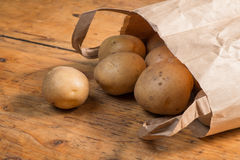 Potatoes in a brown paper bag Royalty Free Stock Photography