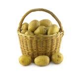 Potatoes in brown wicker basket  closeup Stock Photos