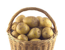 Potatoes in brown wicker basket isolated closeup Stock Image