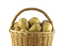 Potatoes in brown wicker basket isolated closeup Royalty Free Stock Image