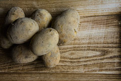 Potatoes on brown wood tray Stock Image
