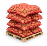 Potatoes in burlap sacks on the pallet Royalty Free Stock Photos