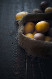 Potatoes in the canvas bag  on the wooden table vertical Royalty Free Stock Image