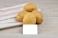 Potatoes and card Stock Photo