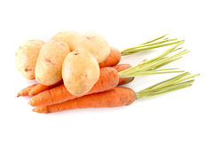 Potatoes and carrots isolated Royalty Free Stock Photography