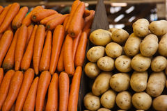 Potatoes and Carrots at Paris market Stock Photography