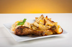 Potatoes and chicken leg Royalty Free Stock Photos