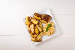 Potatoes and chicken leg Stock Photo