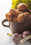Potatoes in a clay pot Royalty Free Stock Photos
