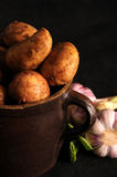 Potatoes in a clay pot Royalty Free Stock Image