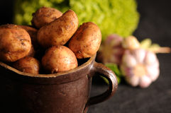 Potatoes in a clay pot Royalty Free Stock Photography