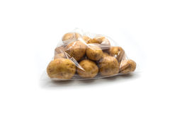 Potatoes in clear plastic bag Stock Image