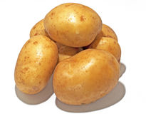 Potatoes. A cluster of potatoes against a white background for use in food related presentations stock image