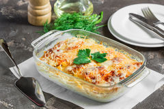 Potatoes cooked in the oven, baked with apples, cheese and green. Potato gratin with cream cheese and fresh herbs Stock Images