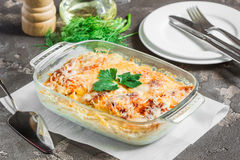 Potatoes cooked in the oven, baked with apples, cheese and herbs. Potato gratin with cream cheese and fresh herbs Stock Images