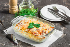Potatoes cooked in the oven with cheese, apples and vegetables. Potato gratin with cream cheese and fresh herbs Royalty Free Stock Photography