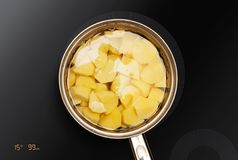 Potatoes is cooked in pan Stock Photo