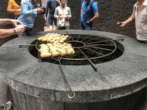 Potatoes cooking above lava oven Stock Images