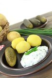 Potatoes and curd Stock Images