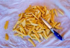 Potatoes cut into shape for french fries royalty free stock photography