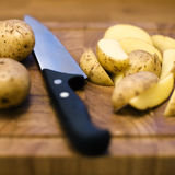 Potatoes on cutting board Royalty Free Stock Photo