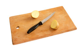 Potatoes on a cutting board. Isolated Stock Photos