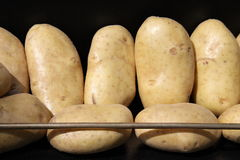 Potatoes on a display stand Stock Photography