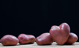 Potatoes in the form of heart Stock Photos