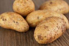Potatoes. Fresh organic potatoes on a wooden board Stock Photography
