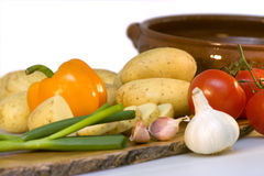 Potatoes and fresh vegetables Stock Photos